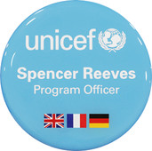 A circle badge light blue backgrounded with UNICEF logo